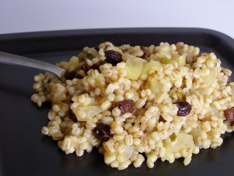 Toasted barley with apples and raisins on a plate